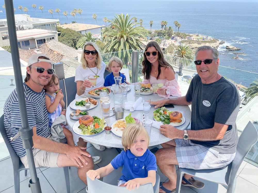 family group at lunch with sea view
