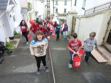 Children walking through Brixham to raise money for Christian Aid