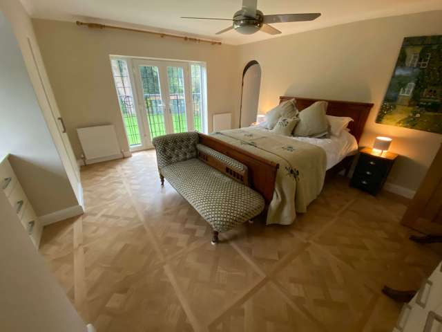 Versailles wood flooring panels in bedroom