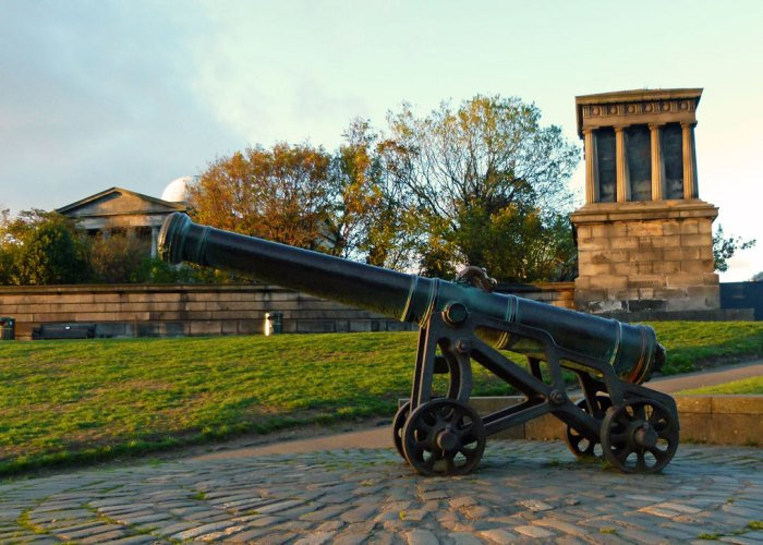 Calton Hill's cannon - behind, part of Edinburgh City's Observatory