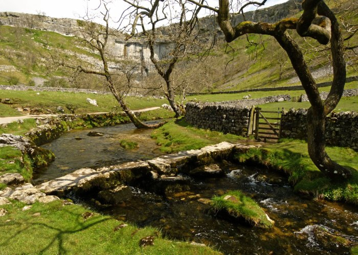 Limestone country. Clapper bridge, Malham Beck, Malham Cove, visit Yorkshire