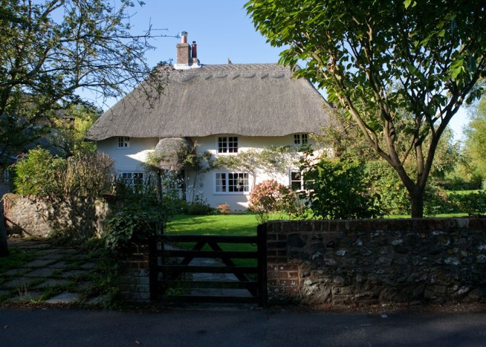 A pretty thatched cottage somewhere in England