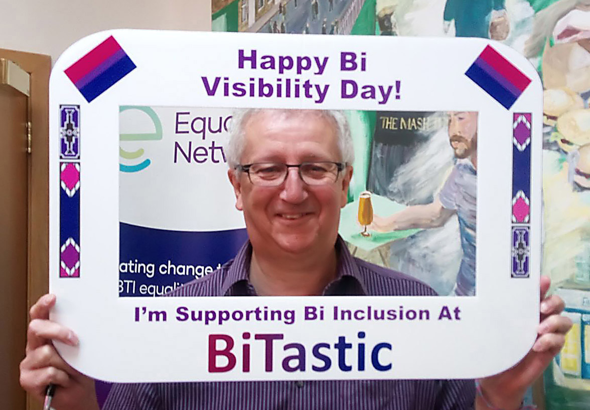 "BiTastic attendee with handheld frame saying ""Happy Bi Visibility Day! I'm supporting Bi Inclusion at BiTastic"""