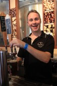 Volunteer Jon Partridge pouring beers