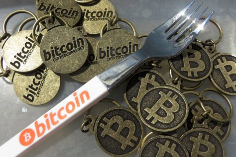 Bitcoin fork pen and bitcoin keychains (Image: BTC Keychain/Flickr)