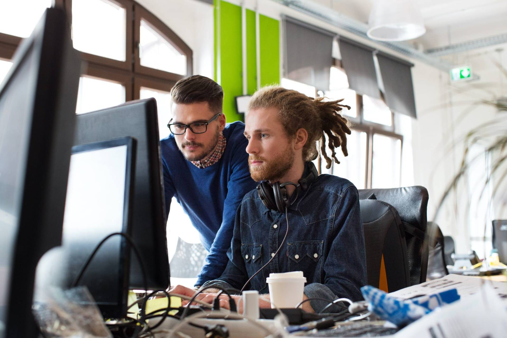 IT professionals working together on desktop PC