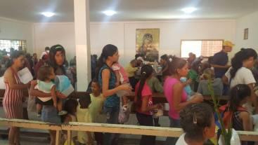 Venezuelans line up at the Bitcoin Venezuela soup kitchen
