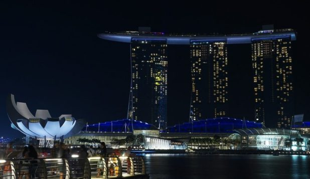 Two Men Charged as Dubious OneCoin Hits Singapore