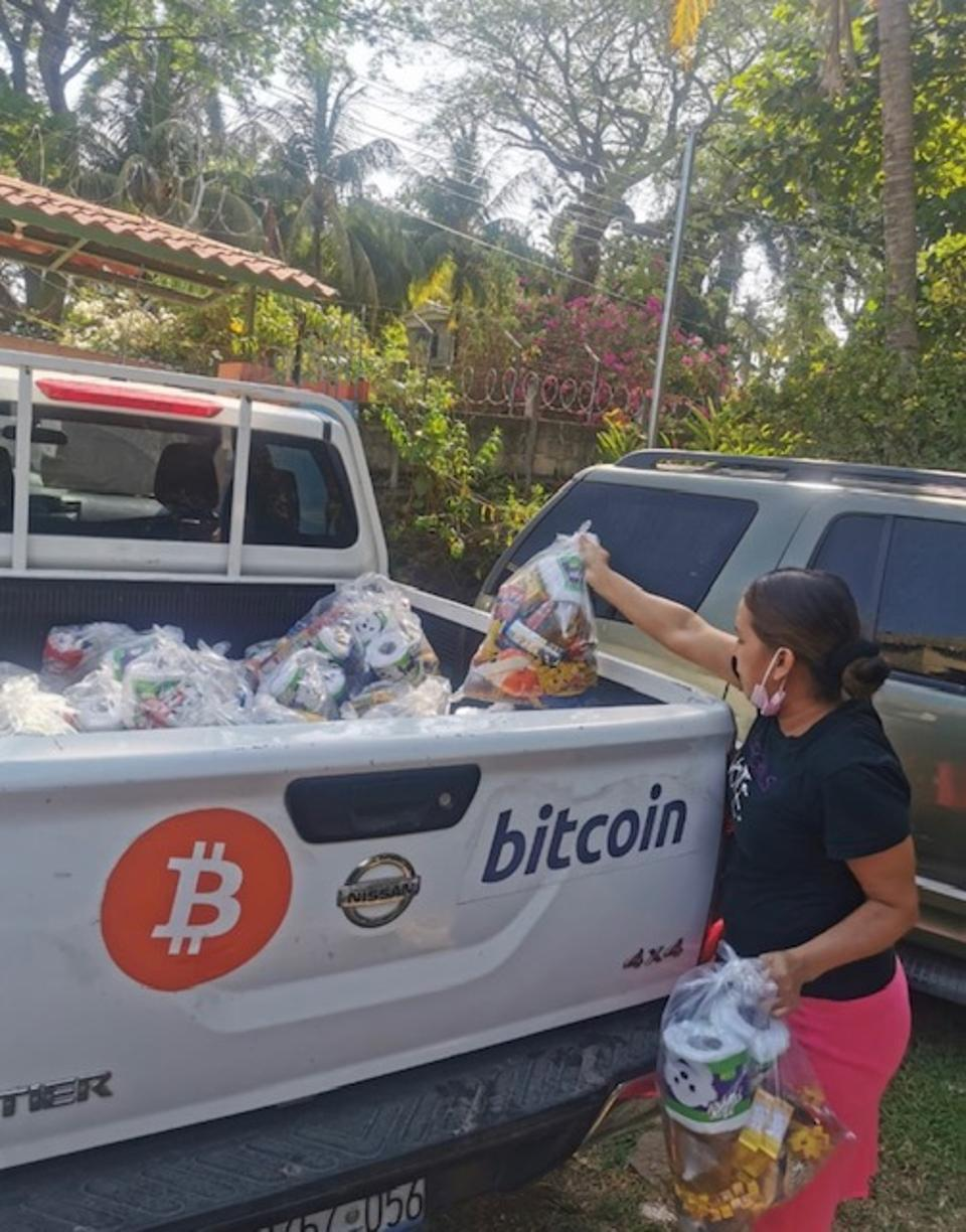 Woman buying necessities using Bitcoin in El Zonte.