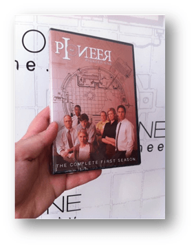 a hand holds up a DVD case for the bitcoin funded Pioneer One TV series