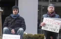 Two Mt. Gox investors sit vigil