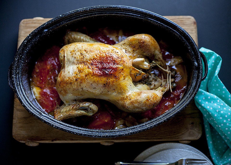 forty clove chicken with tomato, oregano and lemon