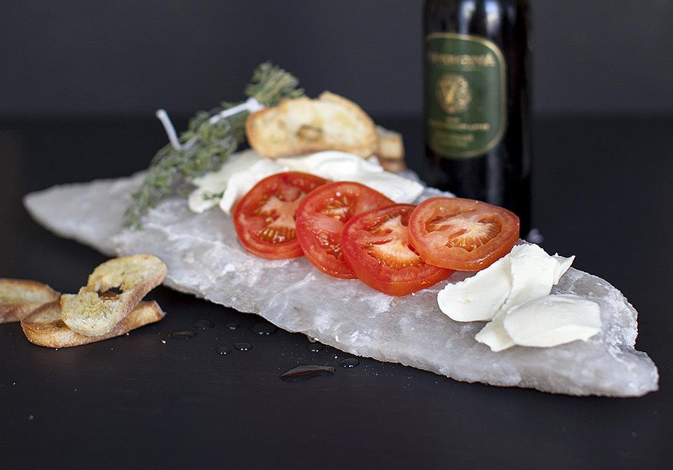 caprese salad on a salt lick