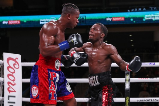 October 12, 2019; Chicago, IL, USA; Charles Conwell and Patrick Day during their October 12, 2019 Matchroom Boxing USA fight at the Wintrust Arena. Mandatory Credit: Ed Mulholland/Matchroom Boxing USA