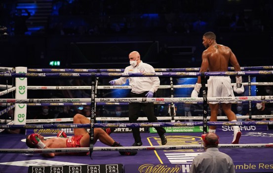 HANDOUT PICTURE COMPLIMENTS OF MATCHROOM BOXING Anthony Joshua vs Kubrat Pulev, IBF, WBA, WBO & IBO World Title. 13 December 2020 Picture By Dave Thompson Anthony Joshua watches as Pulev receives the count.