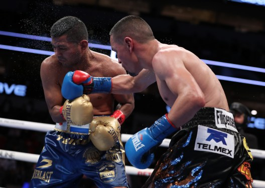 """March 13, 2021; Dallas, TX; Juan Francisco """"El Gallo"""" Estrada and Roman """"Chocolatito"""" Gonzalez during their WBC, WBA and Ring Magazine Super-Flyweight unification fight at the American Airlines Center in Dallas, TX. Mandatory Credit: Ed Mulholland/Matchroom."""
