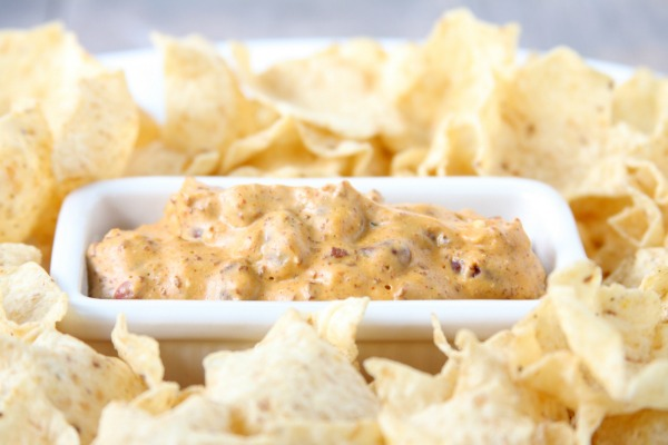 Creamy Bean Dip is perfect for game day, or even an easy appetizer! A simple, delicious recipe with only 4 ingredients! | Chili Cheese Dip | Football Recipe