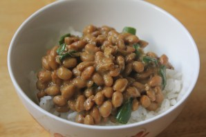 Steamed rice topped with natto, dijon mustard, soy sauce, scallions and dried bonito flakes.