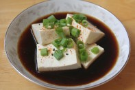 Tofu steamed with dried kelp served with ponzu sauce topped with scallions and shichimi spice.