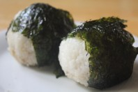 Rice balls filled with bonito and soy sauce, wrapped in seaweed.