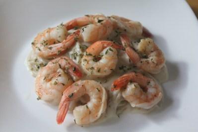 Garlic sautéed shrimp with spaghetti noodles and béchamel sauce.