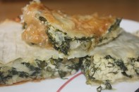 Phyllo pastry filled with spinach, feta cheese, and onions.