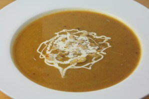 Pumpkin soup made from puréed roasted pumpkin and veggies topped with crème fraîche and roasted pumpkin seeds.