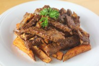 Sweet potato fries topped with sautéed veal strips.