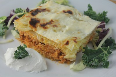 Casserole with layers of savoy cabbage, meat, rice, and sour cream.