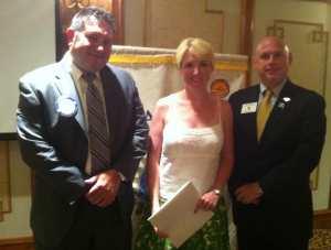 President Brian, New Member Rebecca and DG Rick Bassett
