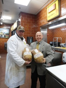 North Haven Rotarian Dr. Richard Bassett, Governor of Rotary District 7980, posed for a photo with a Master Butcher for Fairfield Whole Foods where two large hams were generously discounted for the January 17th Community Supper in North Haven.