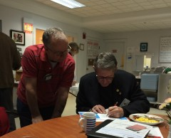 Assistant Governor Jack Solomon assisting Old Saybrook in completing their form