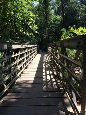 Suspension bridge to the trail.