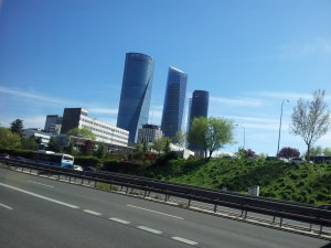 four towers of Madrid takne from a moving vehicle on motorway out of Madrid