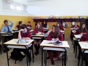 students in a school sitting in rows