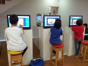 Children reading on computers in a resource centre