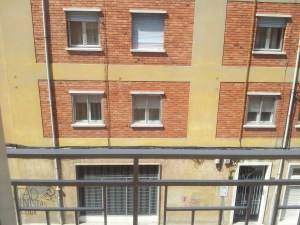 a spanish street - apartment blocks similar to Scottish tenement blocks.  4 storey buildings, utilitarian