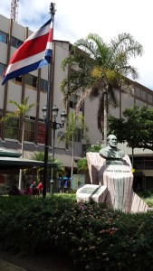 square in San Jose with national flag and statue