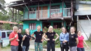 Girls standing in front of accommodation in Puerto Jimenez