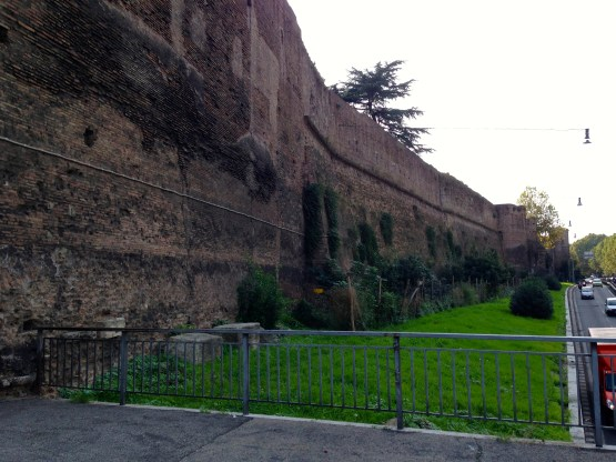 Passing by the original city walls into the oldest part of Rome