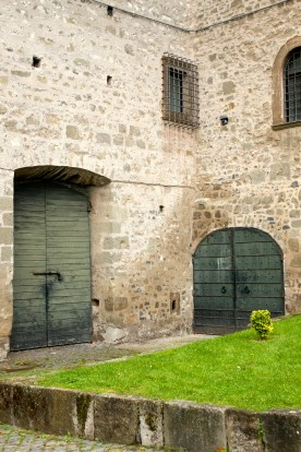 The monks sit right outside these doors and sell wine