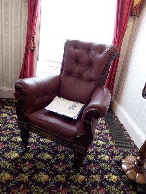 Dickens' armchair in the drawing room. Dickens sat in this chair for the artist George Cruikshank to sketch his portrait in 1837. Cruikshank was also illustrating instalment of Oliver Twist at the time.