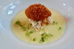 Corn Fed Chicken Consommé, Slow Cooked Chicken Thigh, Roasted Sweetcorn & Manchego Croqueta with Lemon Balm