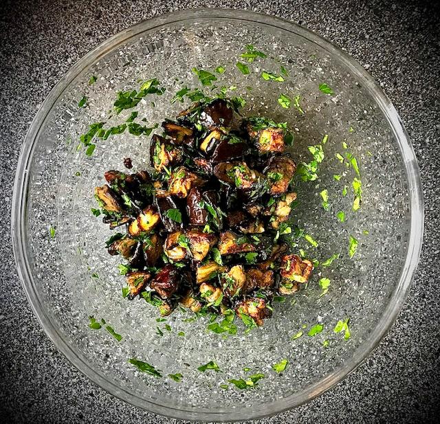 Ben Gibbons Barbequed pork collar steak, chorizo & kale butterbeans, roasted aubergine