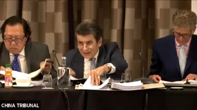 Sir Geoffrey Nice, QC, presiding over the Tribunal. On his right, Andrew Khoo, Malaysian lawyer and international human rights advocate, on his left, Nicholas Vetch, a businessman with particular interest in human rights.