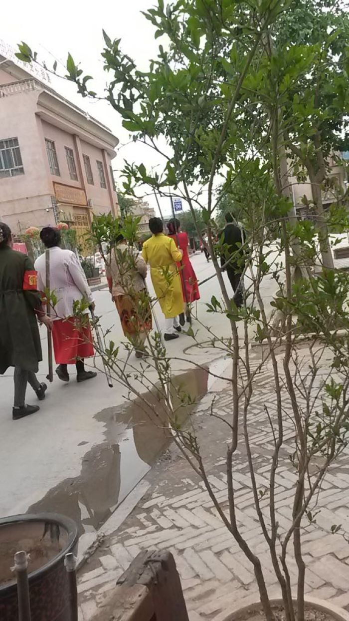 "Kashgar housewives acting as ""home guards"" parading with clubs, sticks and home made weapons."