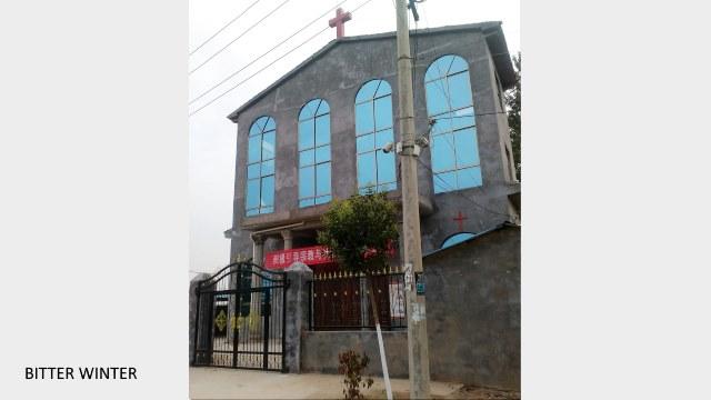 A cross sits atop Xumazhuang Church in Liudian township, Xiayi county, Henan Province.