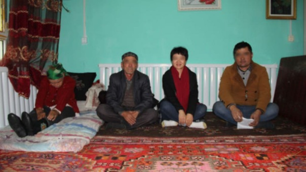 A public official and her Uyghur homestay family