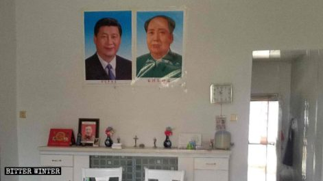 Portraits of Xi Jinping and Mao Zedong are posted