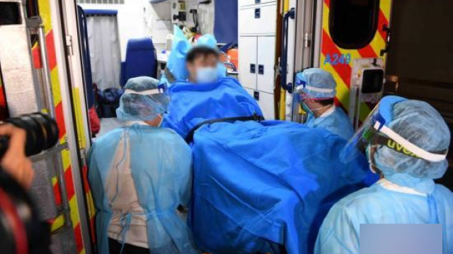 Hong Kong medical staff transferring a patient suspected of having the new coronavirus.
